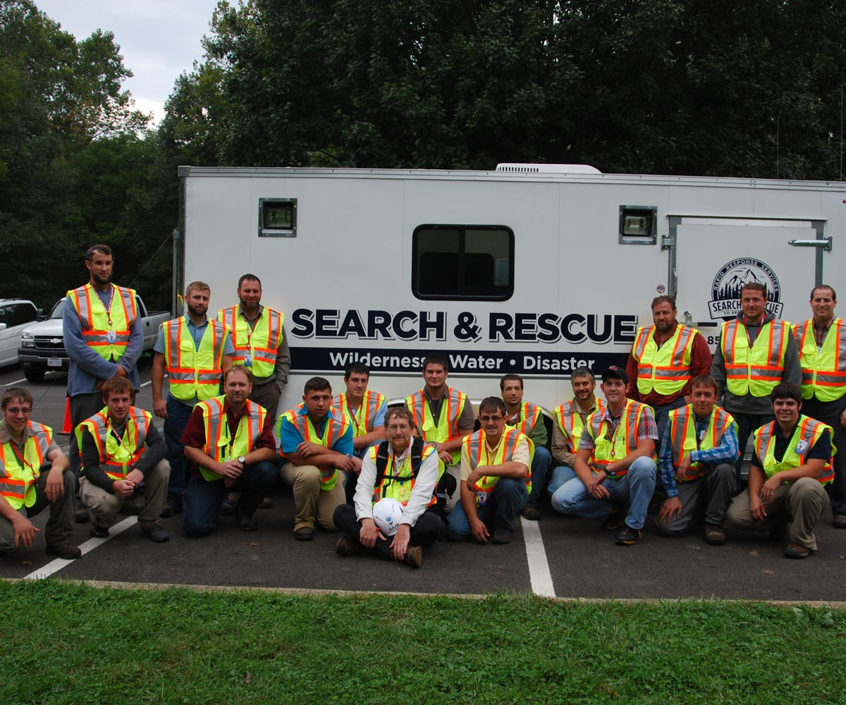 Our search and rescue team in front of an operations trailer